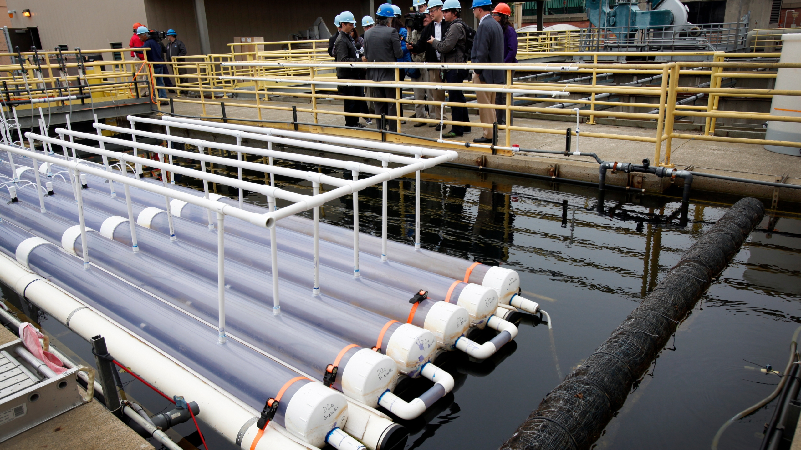 A group of scientists tour of the wastewater biofuel system at the San Francisco Public Utilities Commission's Southeast Water Pollution Control Plant April 17, 2012 in San Francisco, California. (Sarah Rice/Getty Images)
