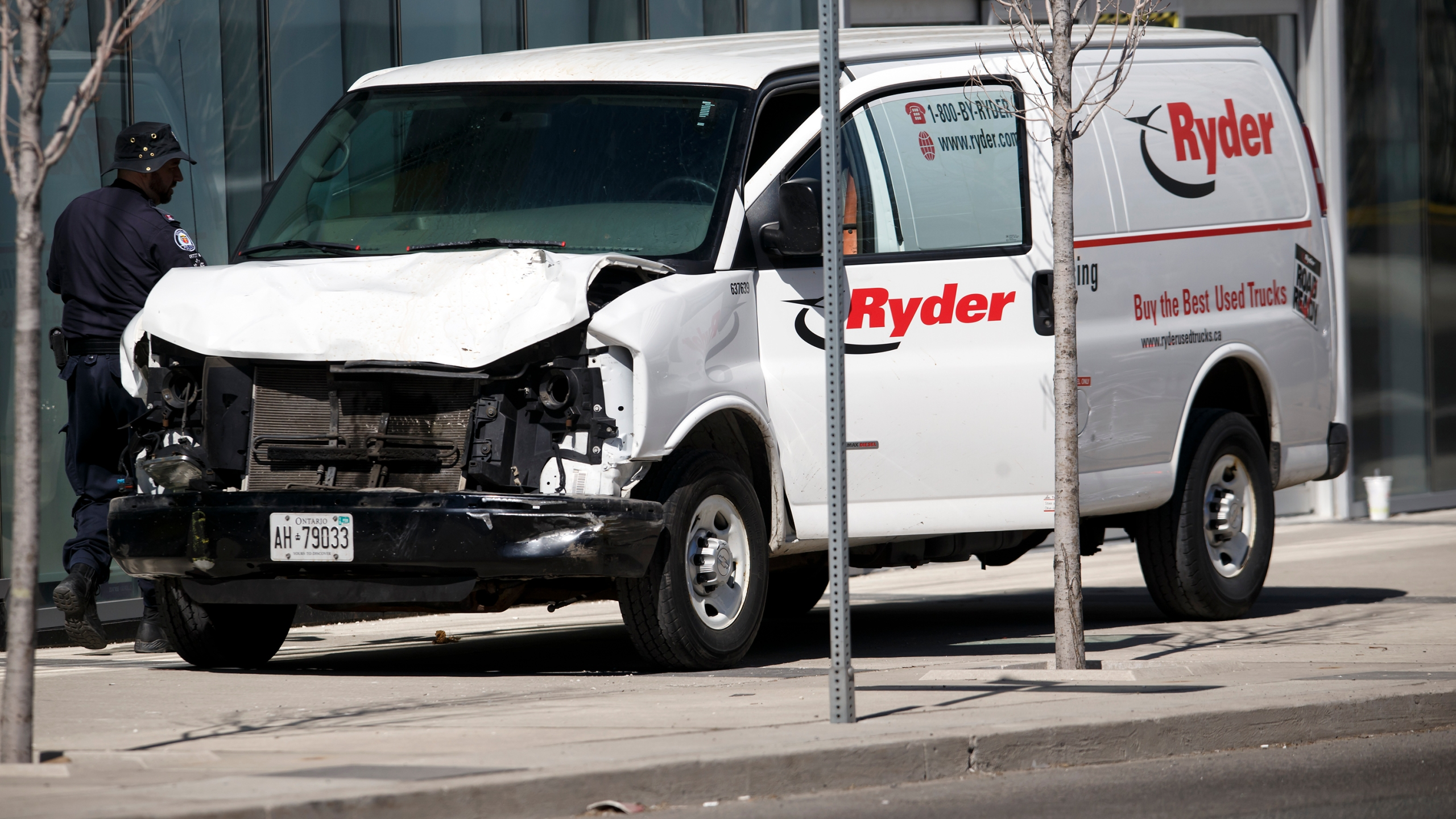 Police inspect a van suspected of being involved in a crash that injured multiple pedestrians on April 23, 2018 in Toronto, Canada. (Cole Burston/Getty Images)