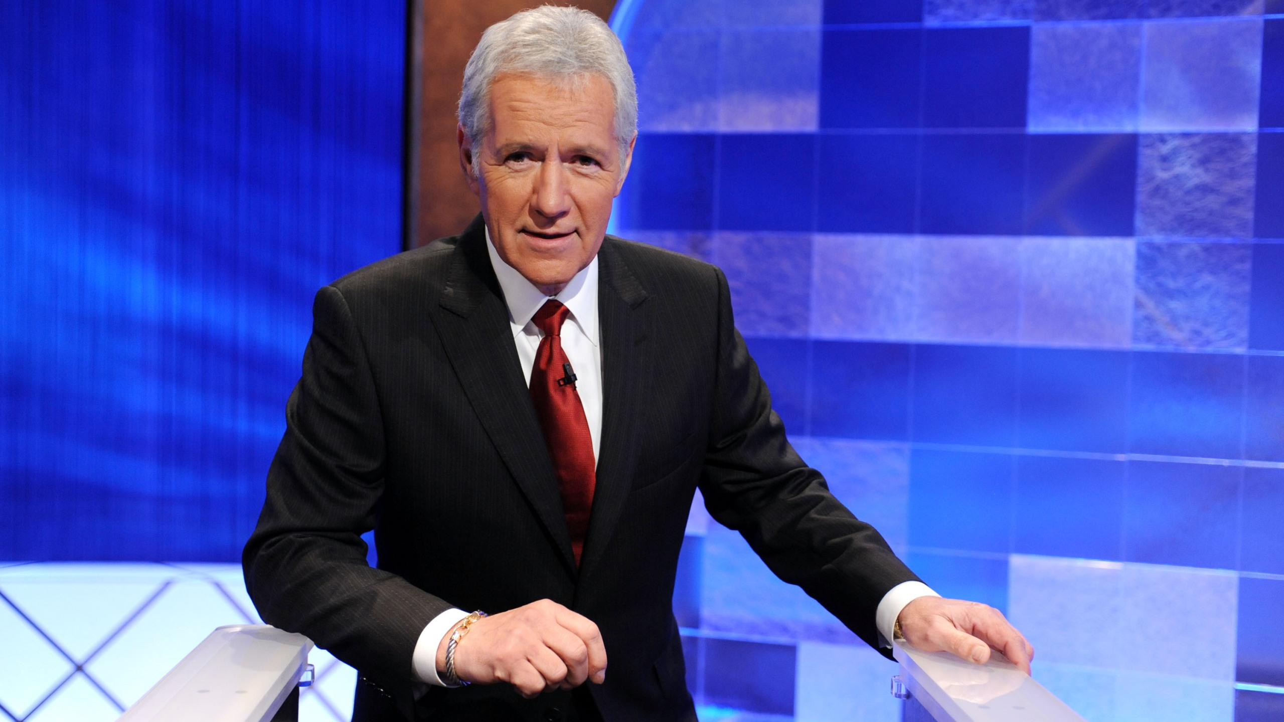 """Game show host Alex Trebek poses on the set of the """"Jeopardy!"""" in Culver City on April 17, 2010. (Amanda Edwards / Getty Images)"""