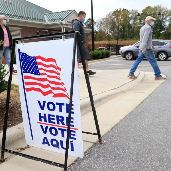 Voters arrive and depart a polling place on Oct.31, 2020 in Yadkinville, North Carolina. (Photo by Brian Blanco/Getty Images)