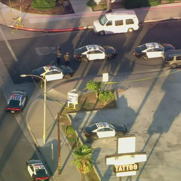 Officers search for a possible suspect in Anaheim on Nov. 9, 2020. (KTLA)