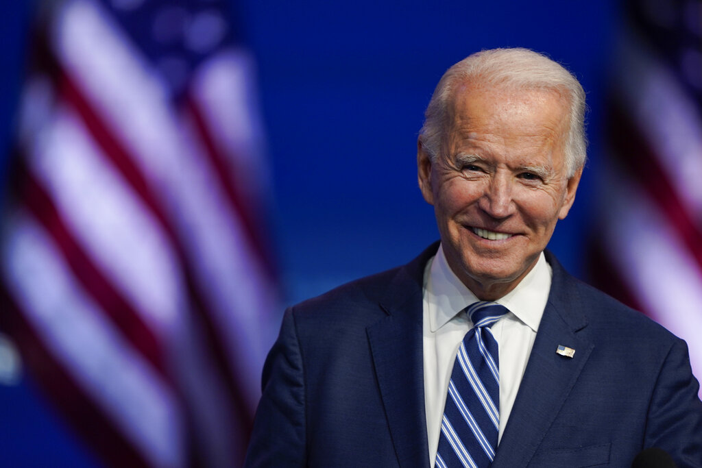 President-elect Joe Biden smiles as he speaks at The Queen theater in Wilmington, Del. on Nov. 20, 2020. (AP Photo/Carolyn Kaster, File)