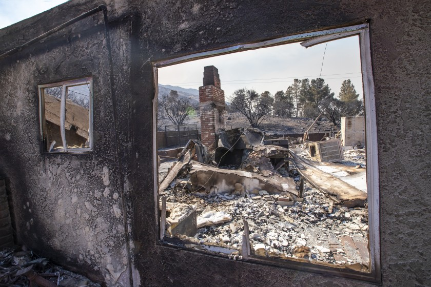 The remains of a burned home in the Bobcat fire in the Angeles National Forest in Juniper Hills.(Allen J. Schaben / Los Angeles Times)