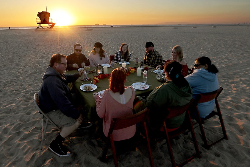 Members of the Hobbs-Brown family dine on the sand at Bolsa Chica State Beach.(Luis Sinco / Los Angeles Times)