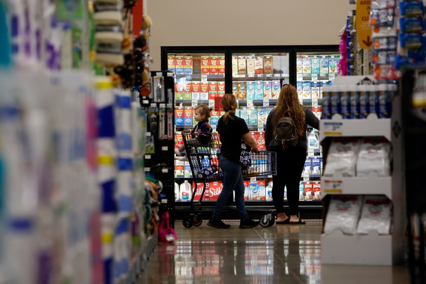 People shop at a Smart & Final Extra! at Jordan Downs Plaza in Watts. The California Grocers Assn. is urging consumers to try to avoid crowds.(Dania Maxwell / Los Angeles Times)