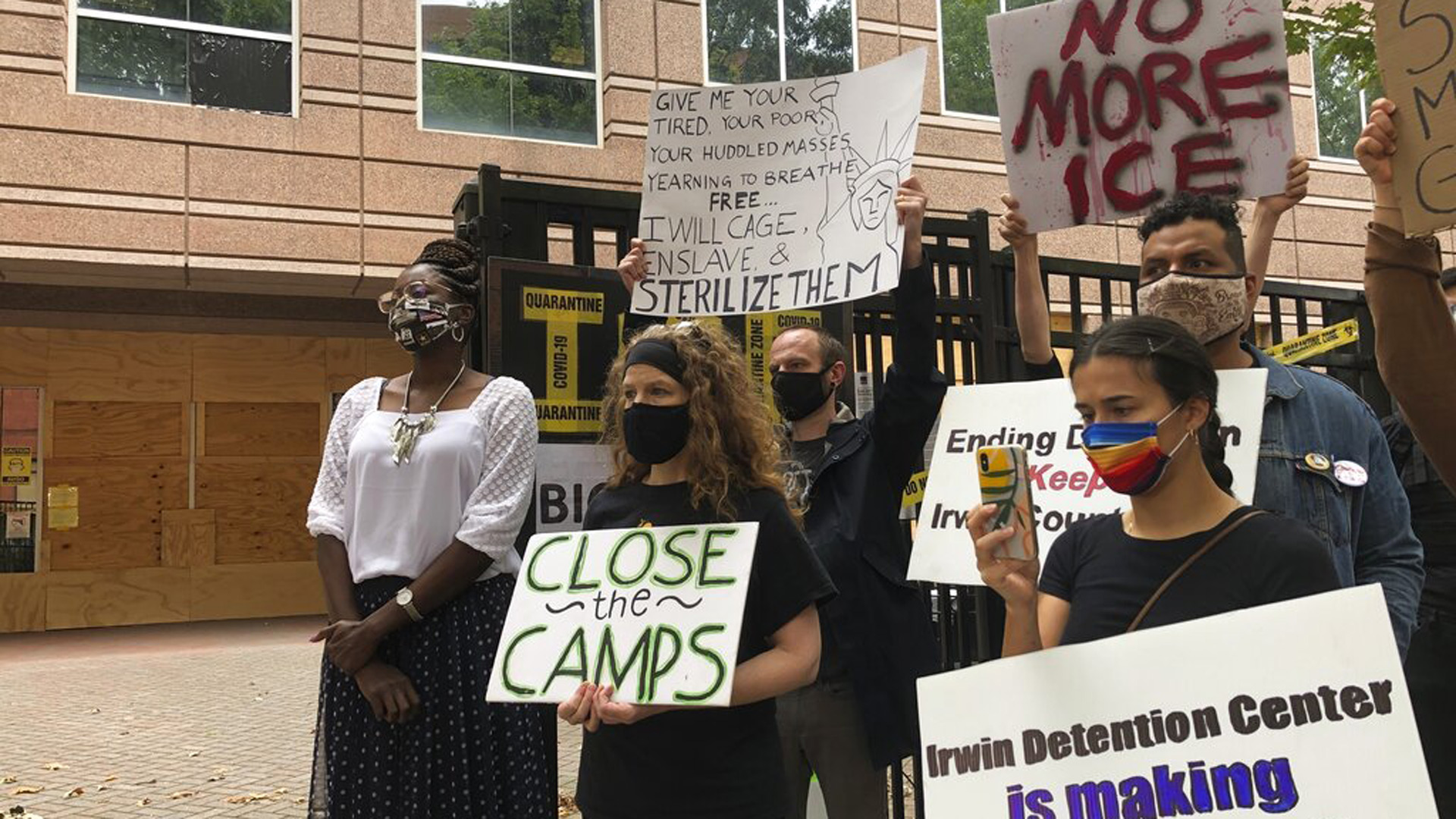 In this Sept. 15, 2020, file photo, Dawn Wooten, left, a nurse at Irwin County Detention Center in Ocilla, Georgia, speaks at a news conference in Atlanta protesting conditions at the immigration jail. (AP Photo/Jeff Amy, File)