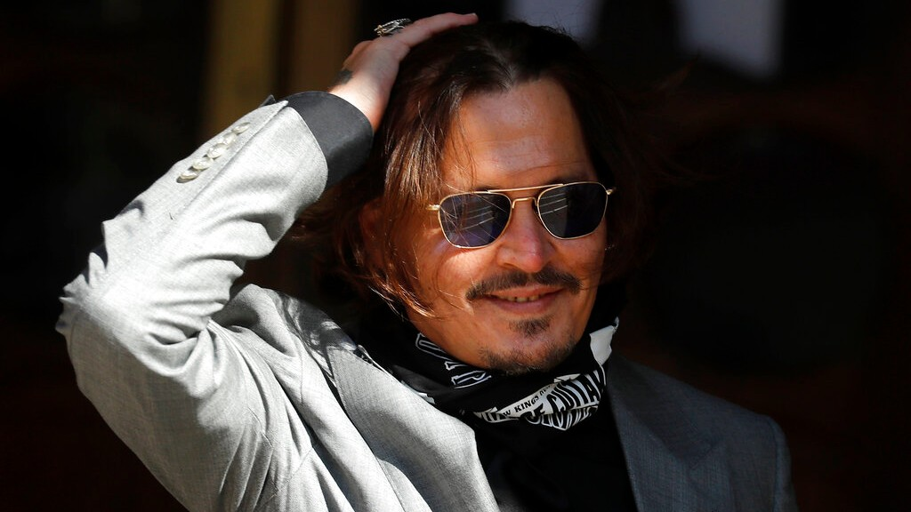 In this file photo dated Tuesday, July 28, 2020, US Actor Johnny Depp arrives at the High Court in London during his case against News Group Newspapers. (AP Photo/Frank Augstein, FILE)