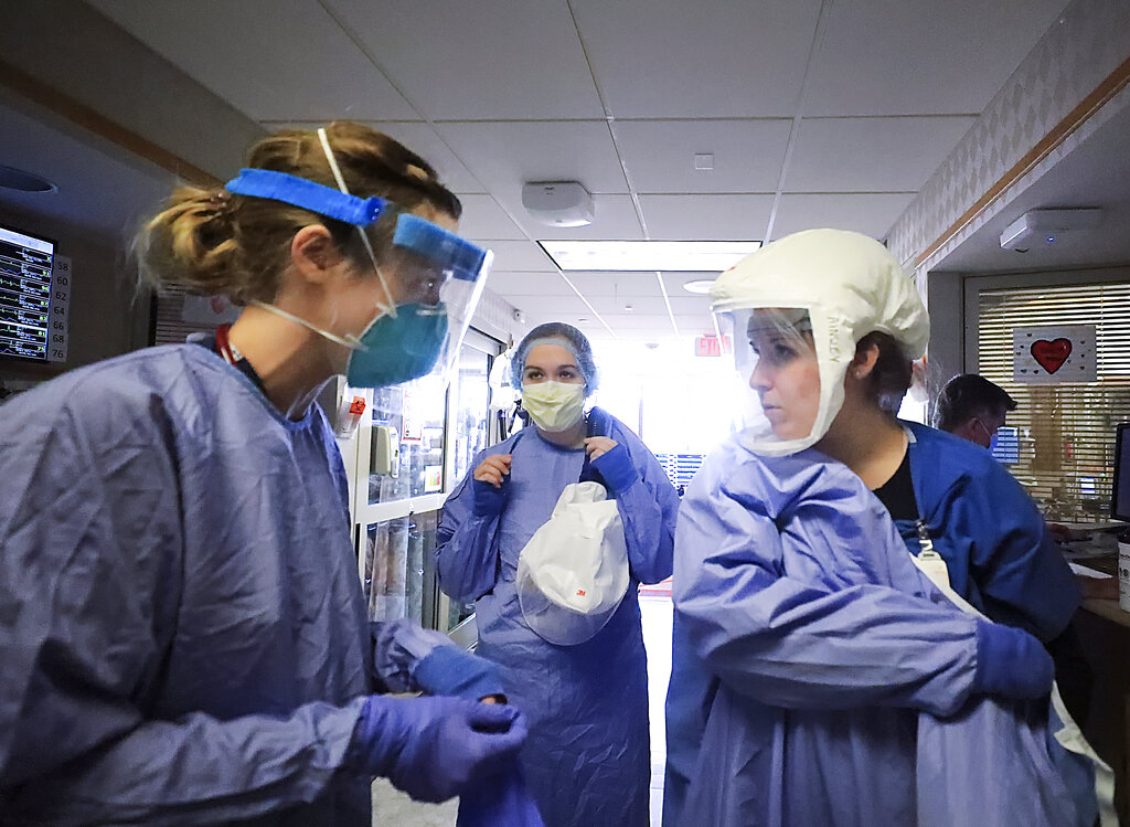 Medical staff attending to patients with COVID-19 wear protective equipment in a unit dedicated to treatment of the coronavirus at UW Health in Madison, Wis. (John Hart/Wisconsin State Journal via AP, File)