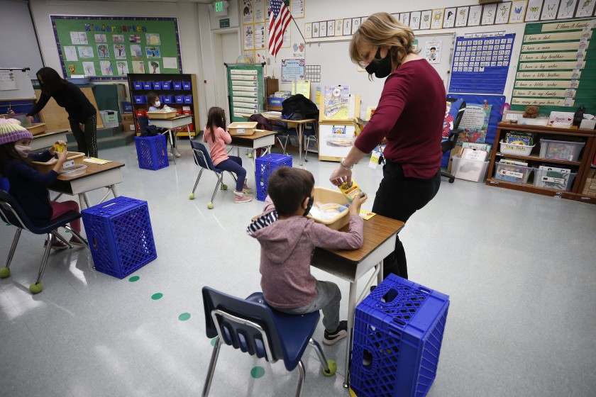 A kindergarten teacher collects crayons from students in her classroom at Lupin Hill Elementary School in Calabasas on Nov. 9, 2020. (Al Seib / Los Angeles Times)