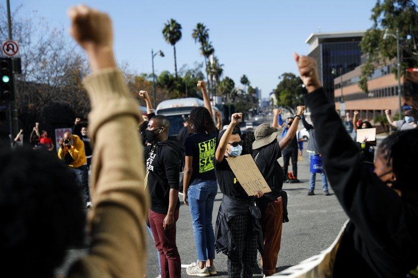 Demonstrators stop traffic near Los Angeles Mayor Eric Garcetti's home in Windsor Square on Nov. 30, 2020, the seventh consecutive day of protests there. (Christina House / Los Angeles Times)