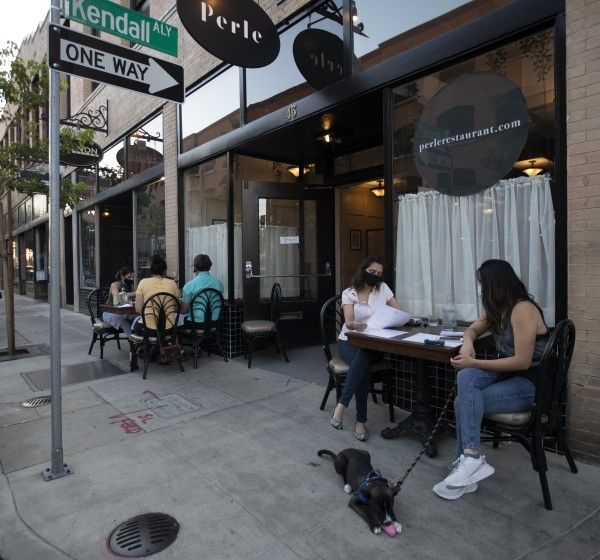 Diners enjoy a meal at Perle, a new French restaurant in Pasadena, in July 2020. (Francine Orr / Los Angeles Times)