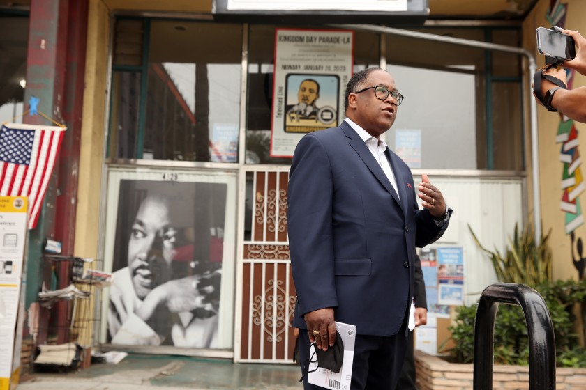 Los Angeles City Council candidate Mark Ridley-Thomas speaks to reporters before voting at Hot and Cool Cafe in Leimert Park on Nov. 3, 2020. (Dania Maxwell / Los Angeles Times)