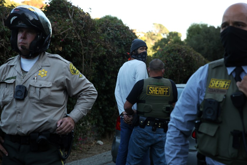 Emanuel Padilla is arrested after a protest outside Sheriff Alex Villanueva's home in La Habra Heights on Nov. 18, 2020. (Dania Maxwell / Los Angeles Times)