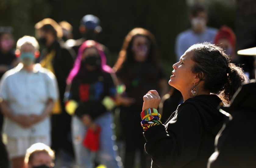 Melina Abdullah, co-founder of the Los Angeles chapter of Black Lives Matter, speaks at a demonstration outside Mayor Eric Garcetti's house on Nov. 30, 2020. (Christina House/Los Angeles Times)
