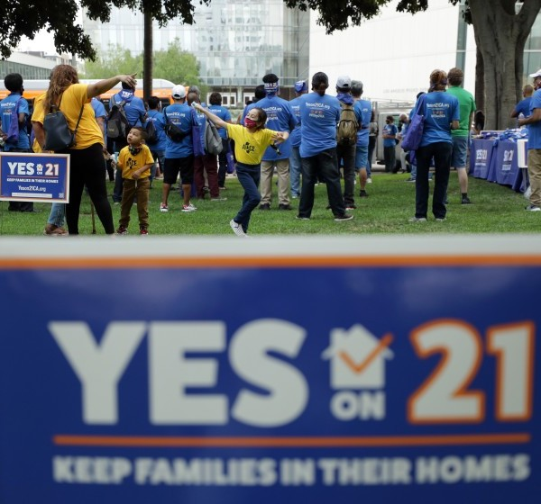 People attend a September 2020 rally in Los Angeles in support of a rent control ballot initiative. (Myung J. Chun / Los Angeles Times)