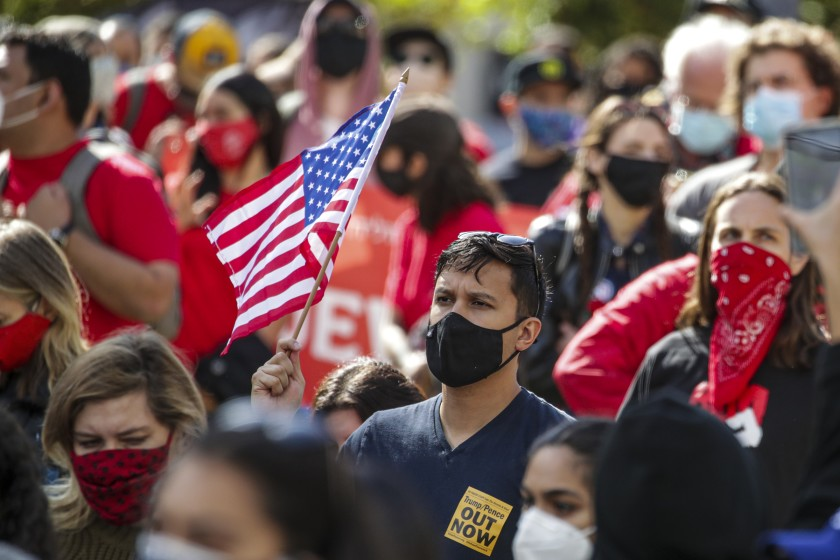 A protest turned into a celebration at Pershing Square in Los Angeles on Saturday after Joe Biden and his running mate, Kamala Harris, were announced the winners of the 2020 election. (Irfan Khan / Los Angeles Times)