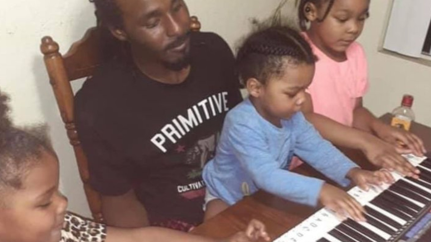 Tavea Tarlton and his family are seen in a photo posted to a GoFundMe account.