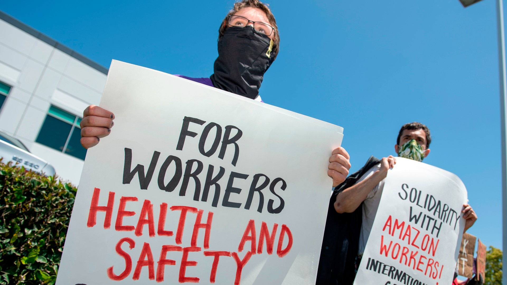 Workers protest against the failure from their employers to provide adequate protections in the workplace of the Amazon delivery hub on National May Day Walkout/Sickout by workers at Amazon, Whole Foods, Innstacart and Shipt amid the Covid-19 pandemic on May 1, 2020, in Hawthorne, California. (VALERIE MACON/AFP via Getty Images)