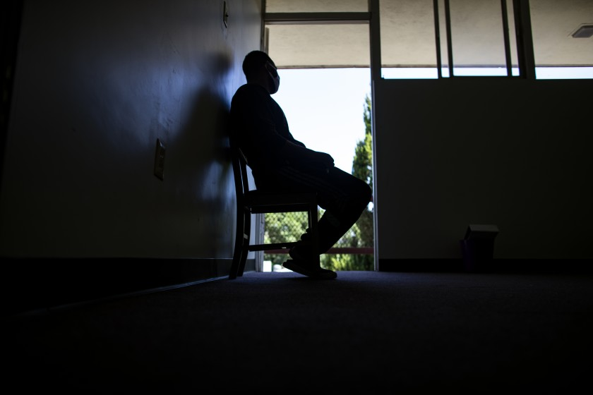 Tsegai sits in the doorway of his room while staying in a church on Sept. 22, 2020 in San Bernardino County. (Gina Ferazzi/Los Angeles Times)