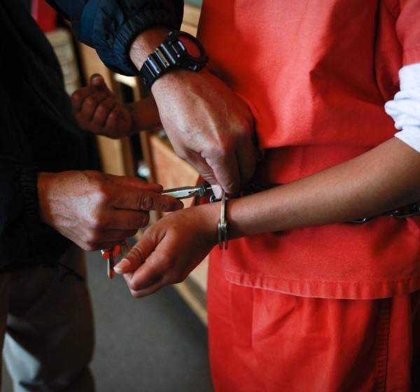 A new arrival at Camp Kenyon Scudder has her handcuffs removed at the girls detention center in 2013. The camp is implementing a new health screening program that is trying to address the problems females might face coming into L.A. County's juvenile justice system and flag girls who might need additional help.(Bethany Mollenkof / Los Angeles Times)