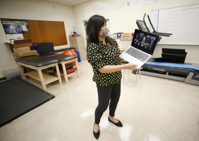 Sports medicine teacher Arlene Alpuerto interacts virtually with students at Eagle Rock Jr./Sr. High School in Los Angeles in 2020. (Al Seib / Los Angeles Times)