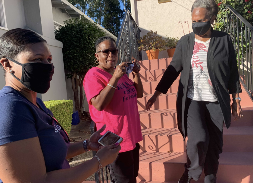 From left: Saniyyah Smith, Sharon McGaffie and Judy Robinson stand on the steps of McGaffie's and Robinson's mother's home in November 2020. They grew up two doors down from vice president-elect Kamala Harris. (Susanne Rust/Los Angeles Times)