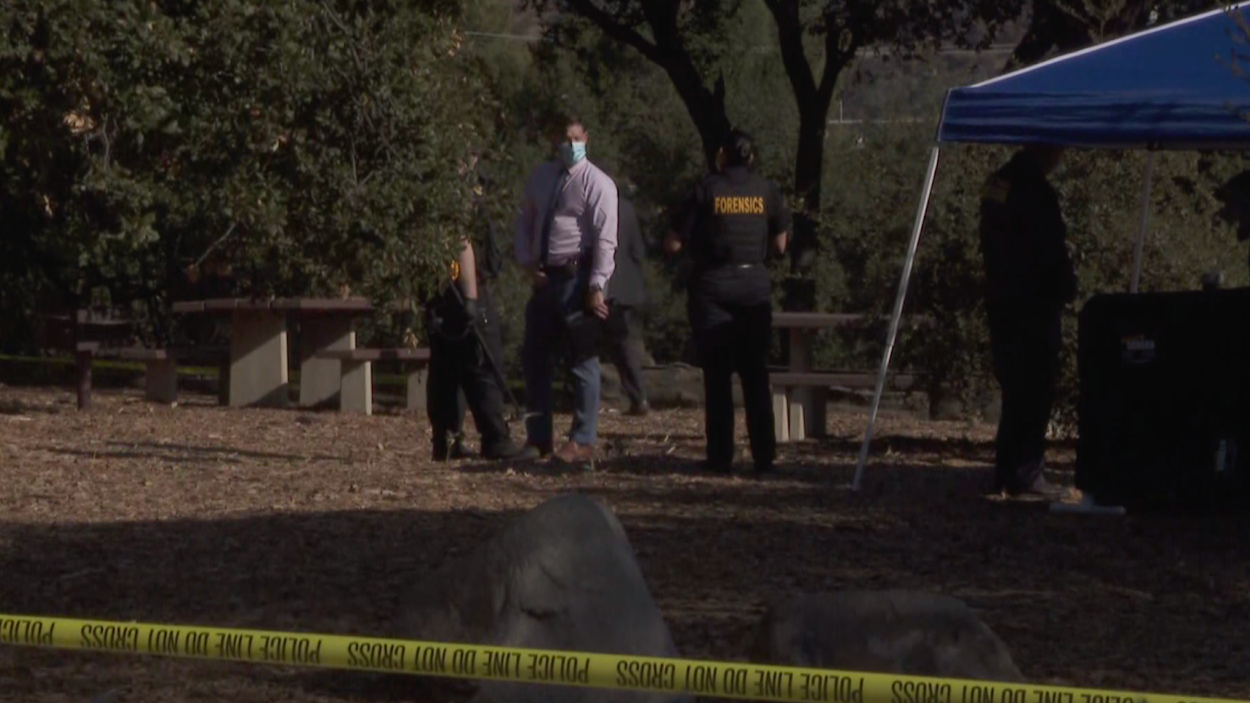 Authorities respond to investigate after a woman was found slain at Hahamongna Watershed Park in Pasadena on Nov. 24, 2020. (KTLA)