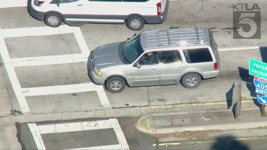 The driver of a gray Lincoln Navigator leads California Highway Patrol officers on a pursuit on the 405 Freeway. (Sky5)