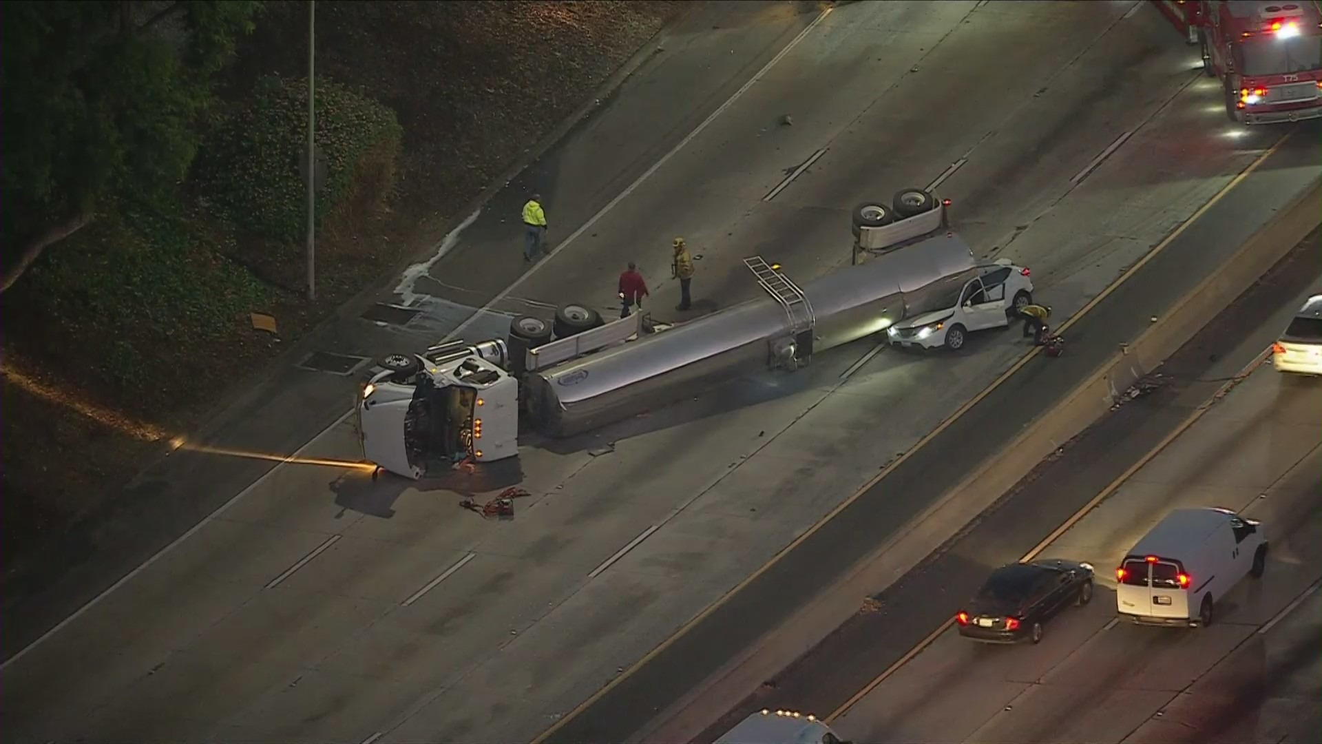 Emergency crews respond to an overturned truck on the 5 Freeway in Lincoln Heights on Nov. 24, 2020. (KTLA)