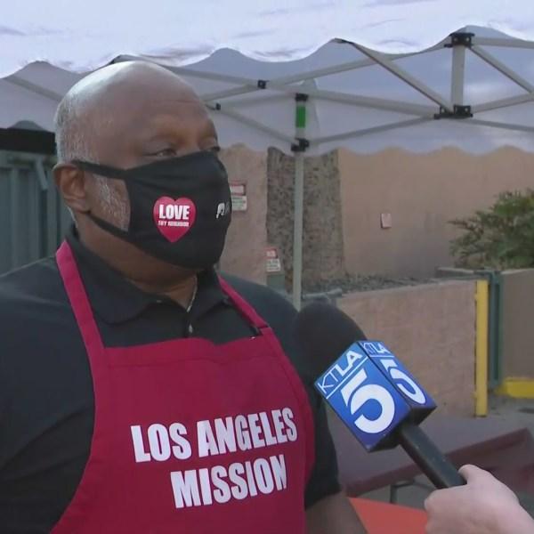 L.A. Mission CEO Troy Vaughn speaks to KTLA during a food distribution event on Skid Row on Nov. 25, 2020. (KTLA)