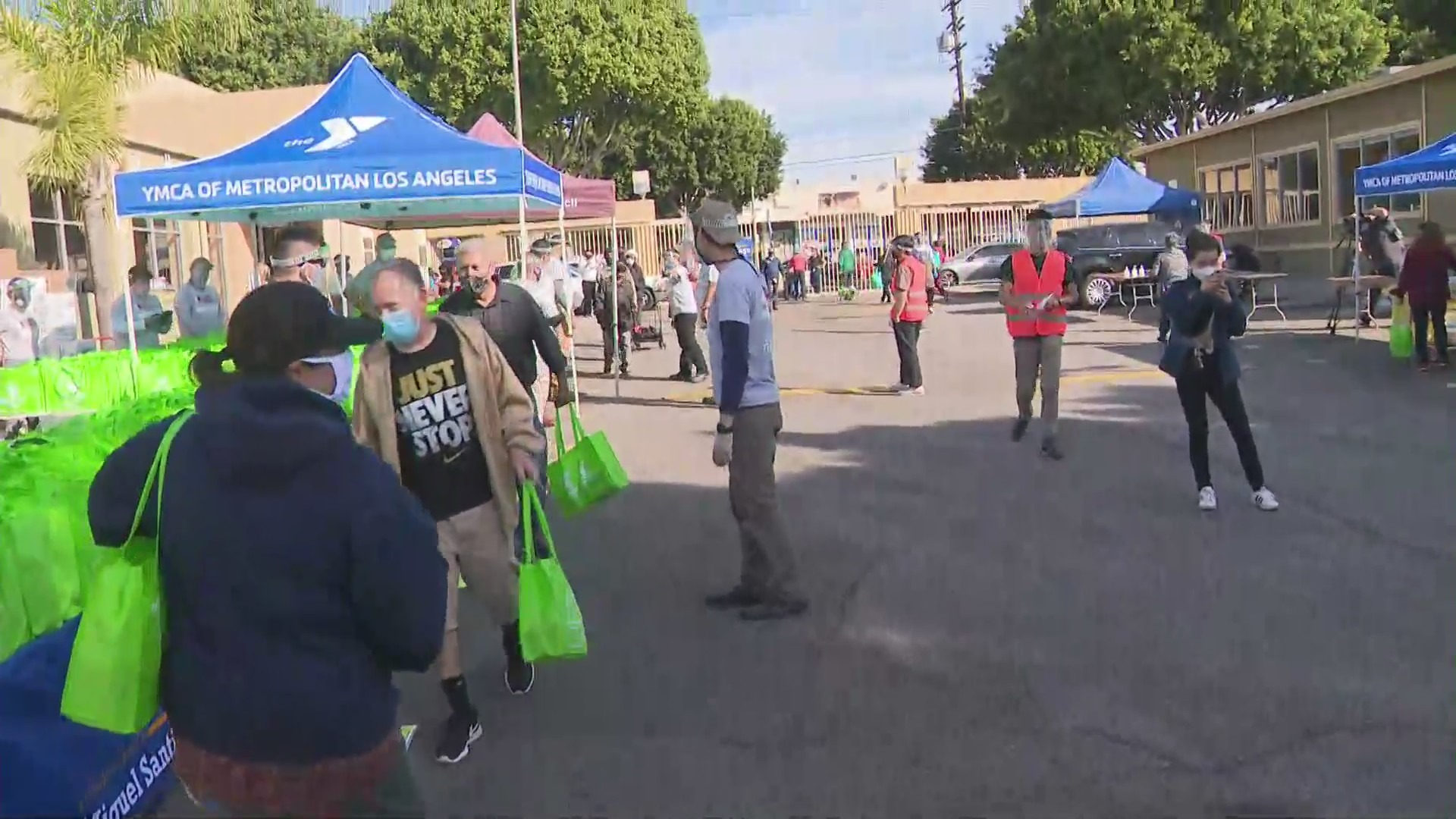Volunteers offer food to those in need at a Boyle Heights distribution event on Nov. 21, 2020. (KTLA)