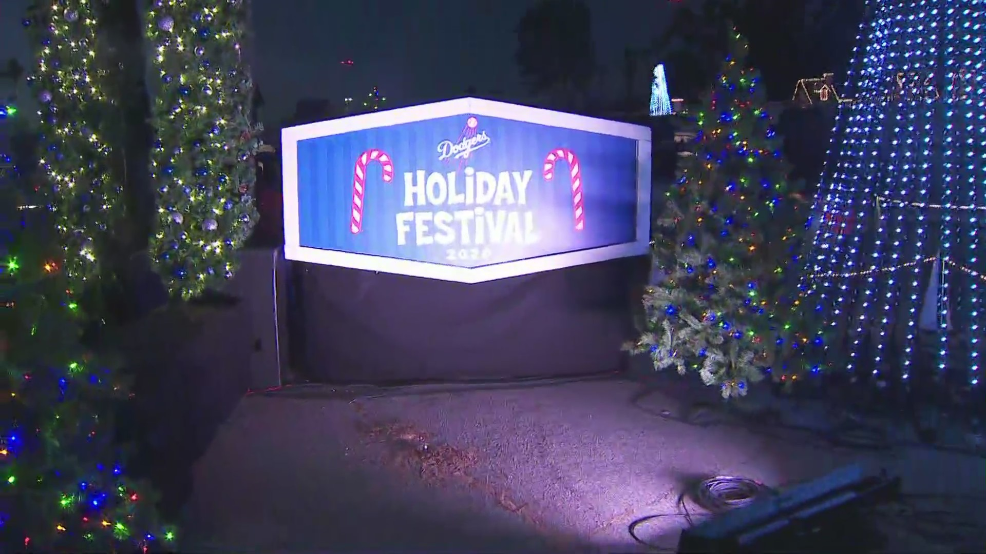 "A sign at the Dodger Stadium reads ""holiday festival"" on Nov. 28, 2020. (KTLA)"