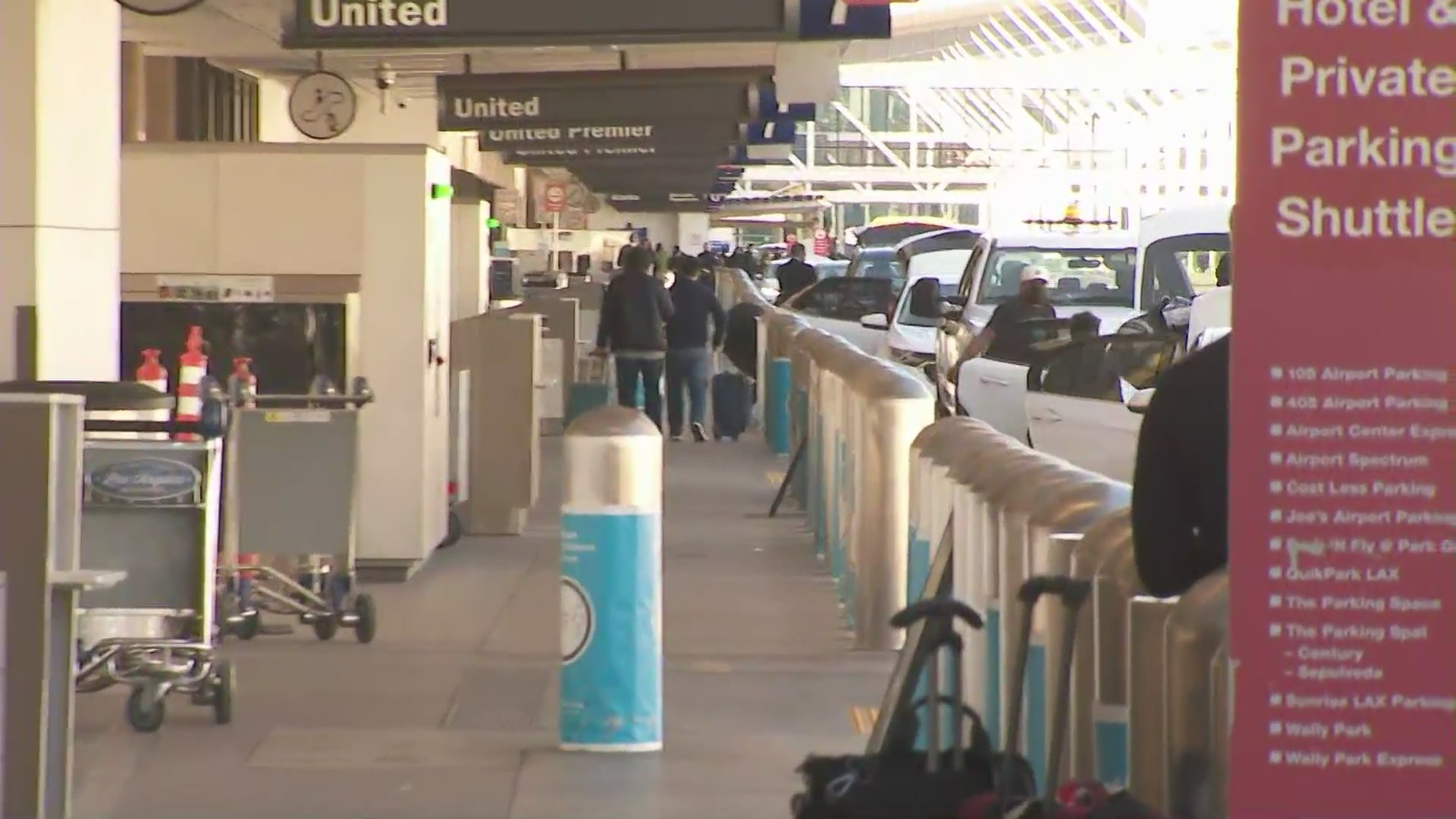 Travelers are seen at the Los Angeles International Airport on Nov. 29, 2020. (KTLA)