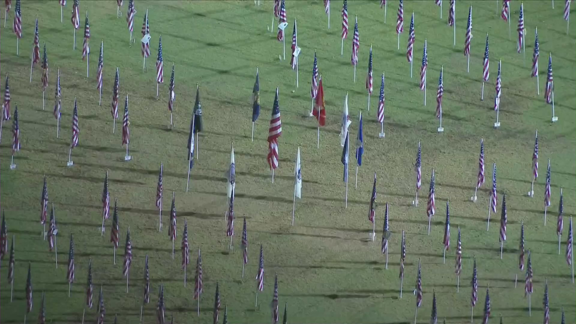 Flags are seen on Veterans Day, Nov. 11, 2020, at a park in Orange County. (KTLA)