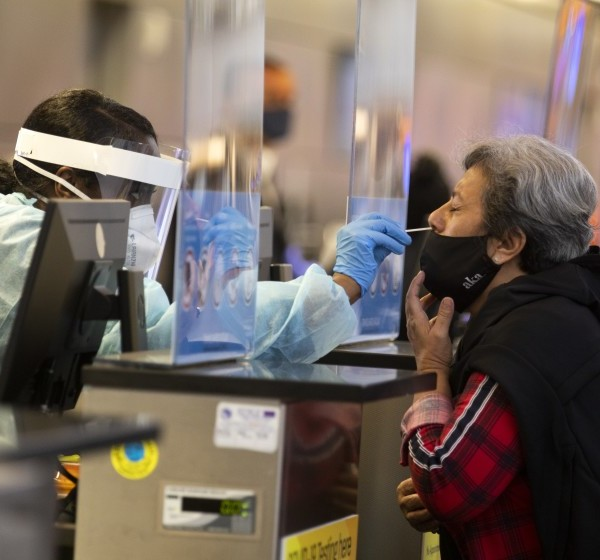 Ana Ramos is tested for the novel coronavirus at Los Angeles International Airport on Tuesday.(Francine Orr / Los Angeles Times)