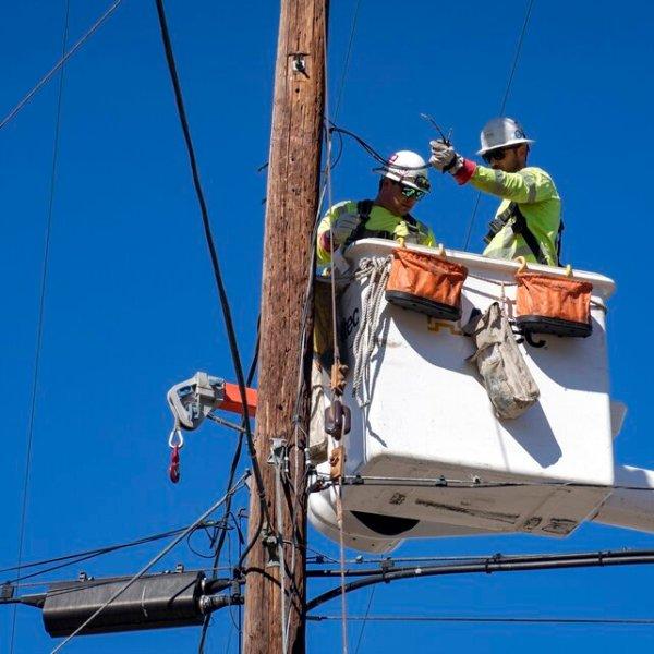 In this Oct. 25, 2019, file photo, Southern California Edison crews replace power lines in Santa Clarita. (AP Photo/ Christian Monterrosa, File)