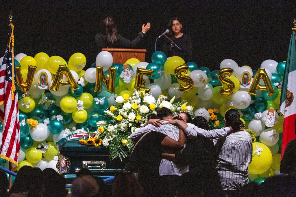 In this Aug. 14, 2020, file photo Alma Garcia embraces Juan Cruz, the boyfriend of Army Spc. Vanessa Guillen at her memorial service on in Houston. (Marie D. De Jesus/Houston Chronicle via AP, Pool, File)