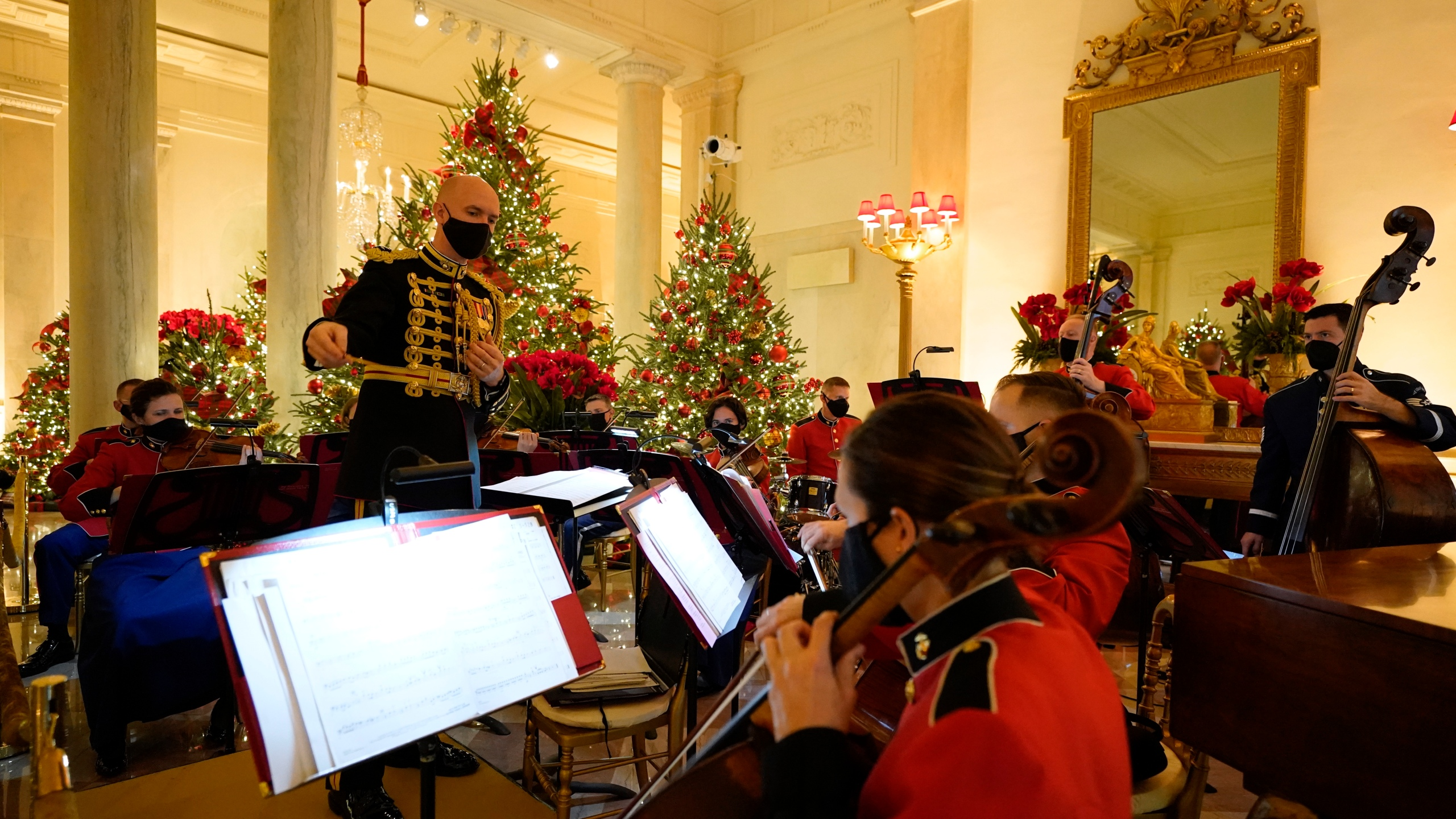A U.S. Marine Corps band performs in the Entrance Hall of the White House during the 2020 Christmas preview on Nov. 30, 2020. (Patrick Semansky / Associated Press)