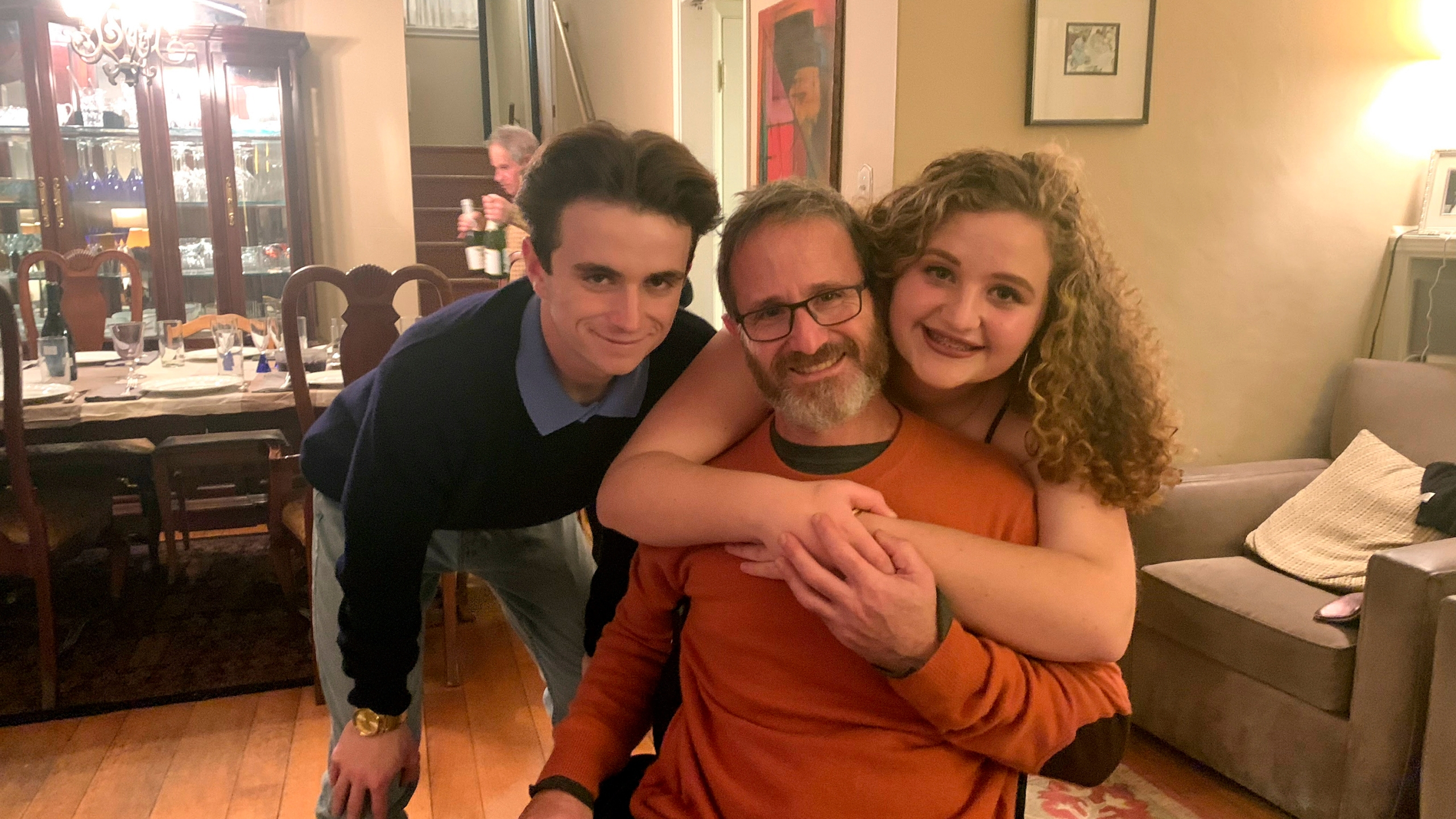 In this November 2019 photo provided by Samuel Kolb, he poses for a photo with his son Jacob and daughter Lexi in San Mateo, Calif. (Elizabeth Robillard/Courtesy of Samuel Kolb via AP)