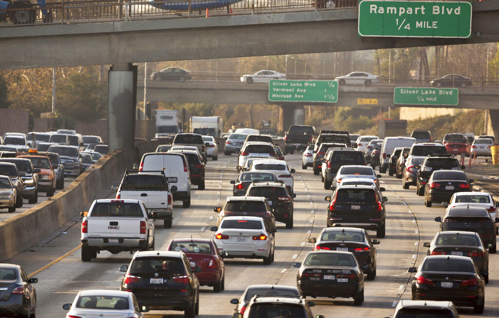 In this Dec. 12, 2018, file photo, traffic moves along the Hollywood Freeway in Los Angeles. (AP Photo/Damian Dovarganes, File)