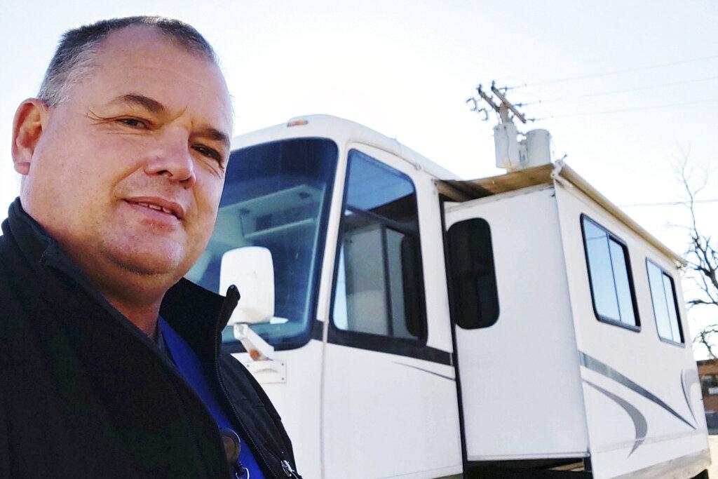 Eric Lewallen takes a photo of himself on Friday, Dec. 4, 2020, in La Crosse, Kansas. (Eric Lewallen via The AP)