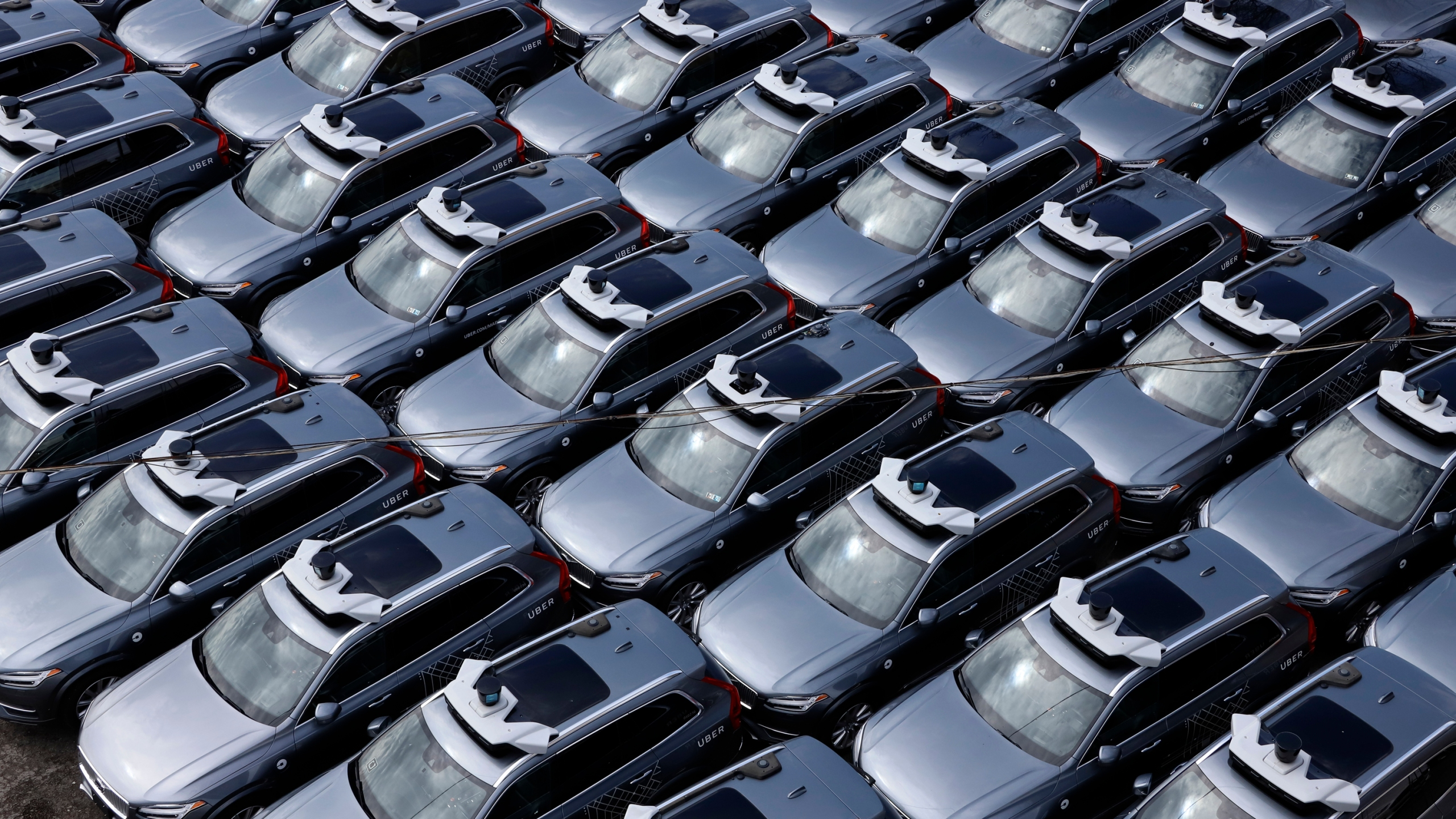 A parking lot full of Uber self-driving Volvos is seen in Pittsburgh on March 20, 2020. (Gene J. Puskar / Associated Press)