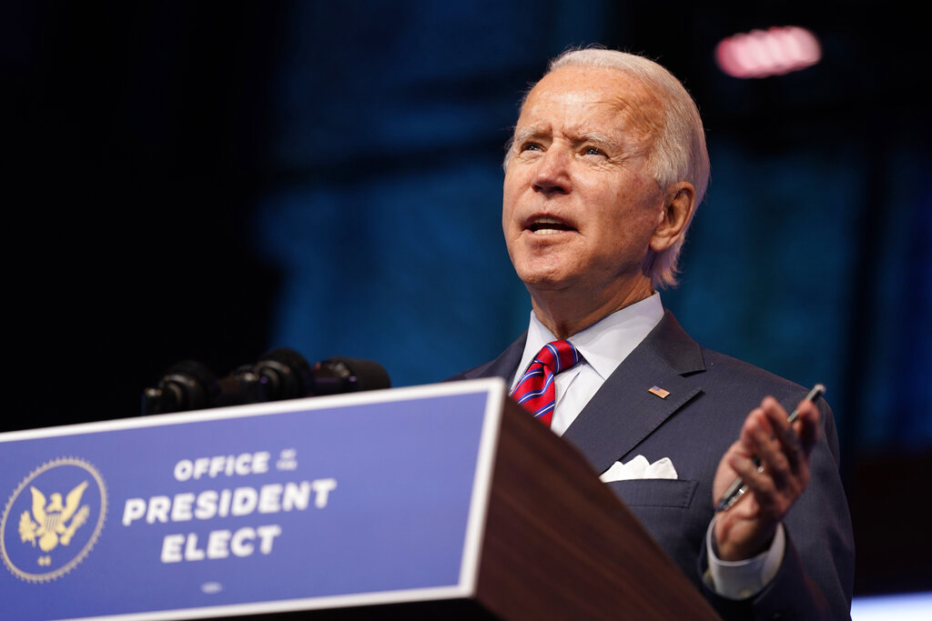 In this Dec. 4, 2020, photo, President-elect Joe Biden speaks about jobs at The Queen theater in Wilmington, Del. (AP Photo/Andrew Harnik)