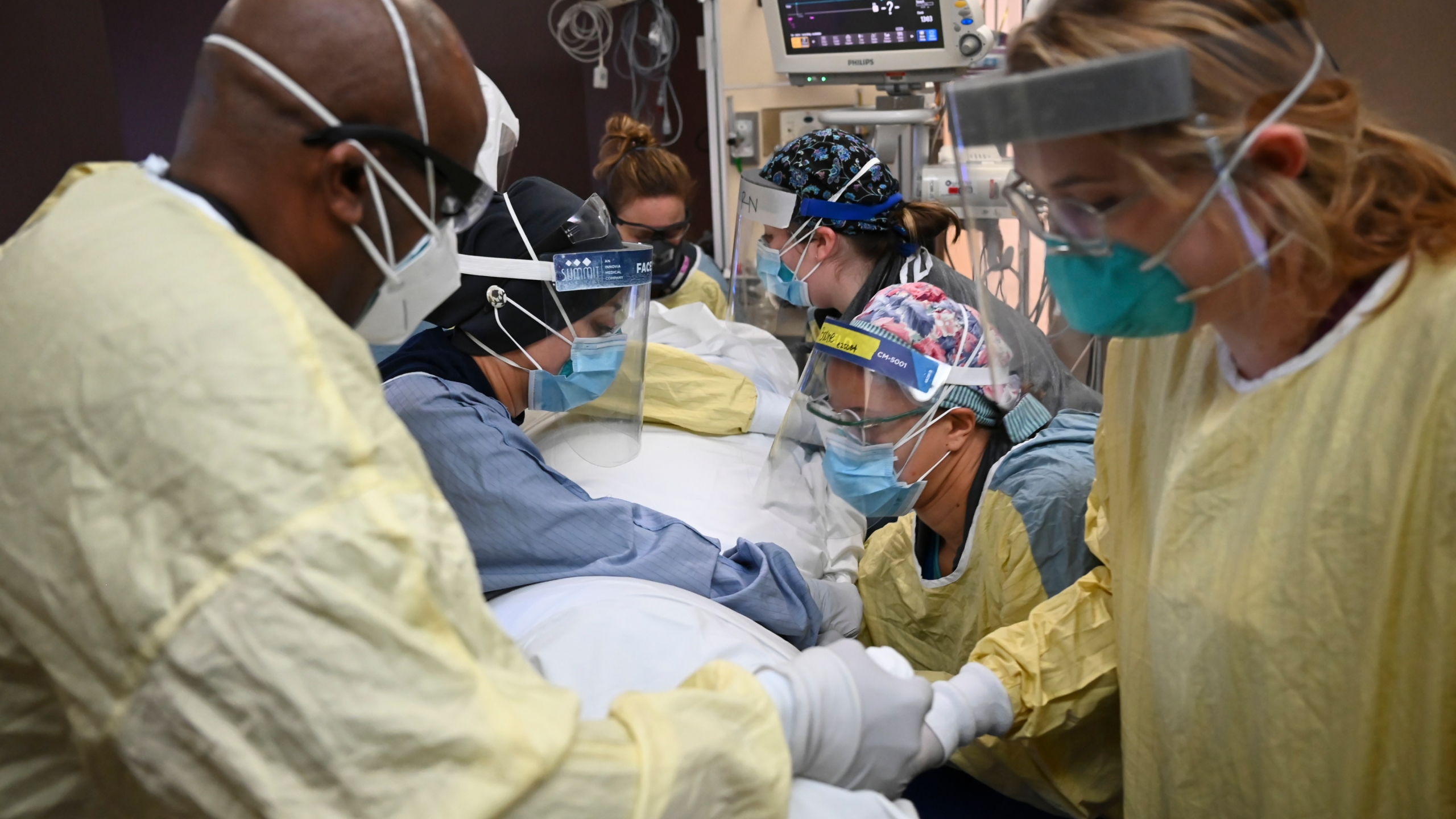 In this Monday, Dec. 7, 2020, file photo, critical care nurses and respiratory therapists flip a patient with COVID-19 upright at North Memorial Health Hospital in Robbinsdale, Minn. Virtually every state is reporting surges in cases and deaths. (Aaron Lavinsky/Star Tribune via AP, File)