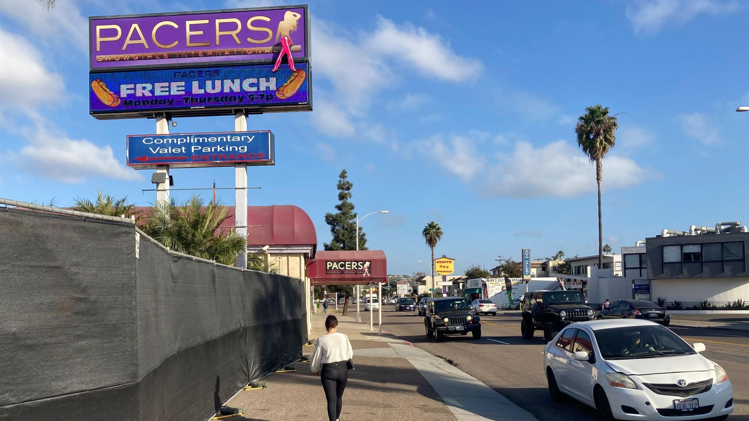 A pedestrian walks past Pacers Showgirls International in San Diego, on Thursday, Dec. 10, 2020. (Elliot Spagat/AP Photo)