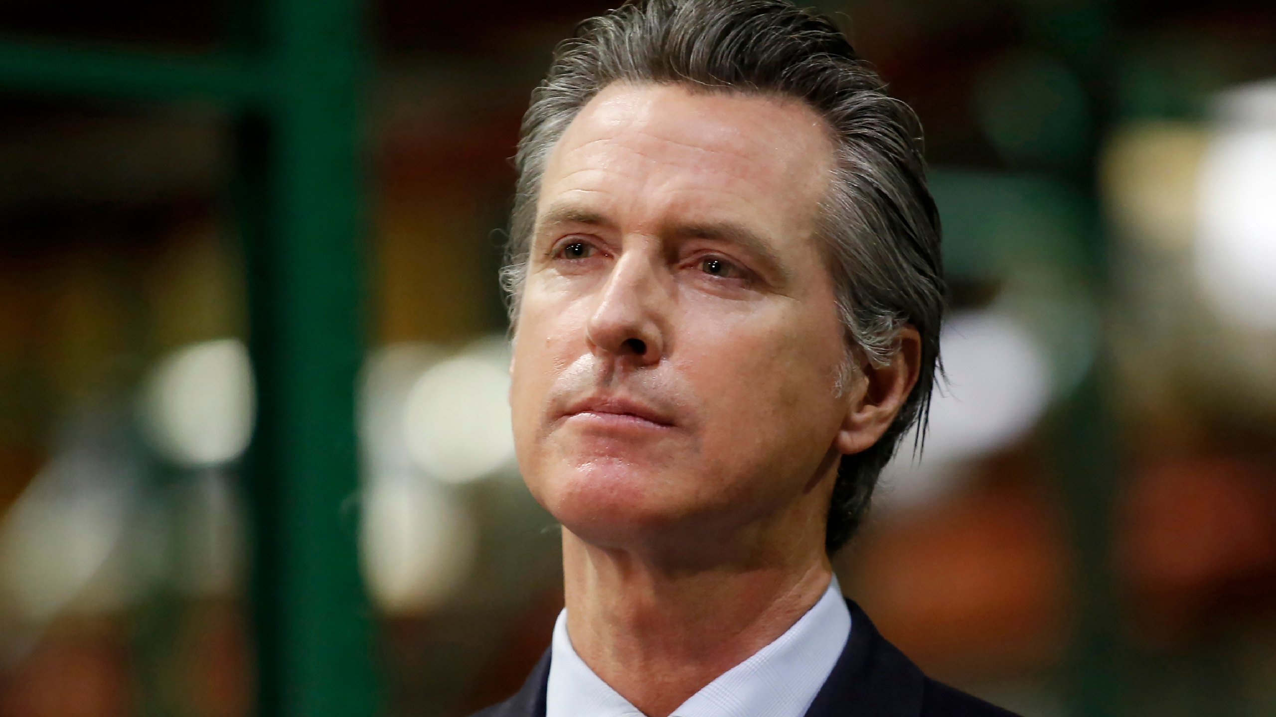 In this June 26, 2020, file photo, California Gov. Gavin Newsom listens to a reporter's question during a news conference in Rancho Cordova, Calif. (AP Photo/Rich Pedroncelli, Pool, File)