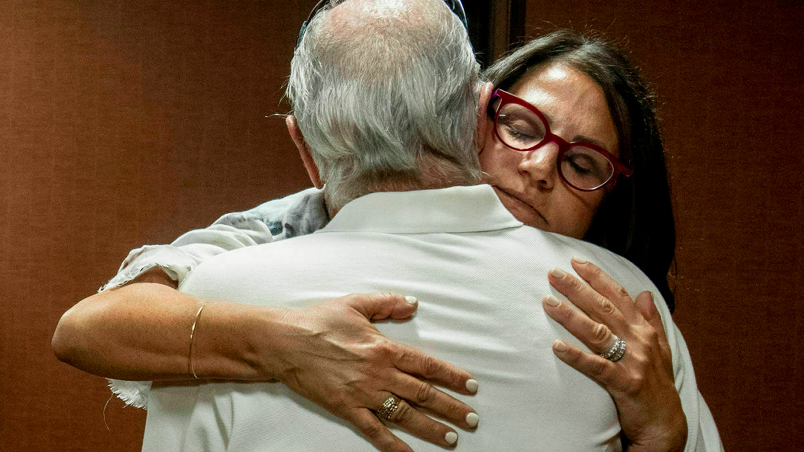 In this July 11, 2019 file photo, Tanya Gersh, a Montana real estate agent, embraces her father Lloyd Rosenstein following a hearing at the Russell Smith Federal Courthouse in Missoula. Mont. (Ben Allen/The Missoulian via AP, File)