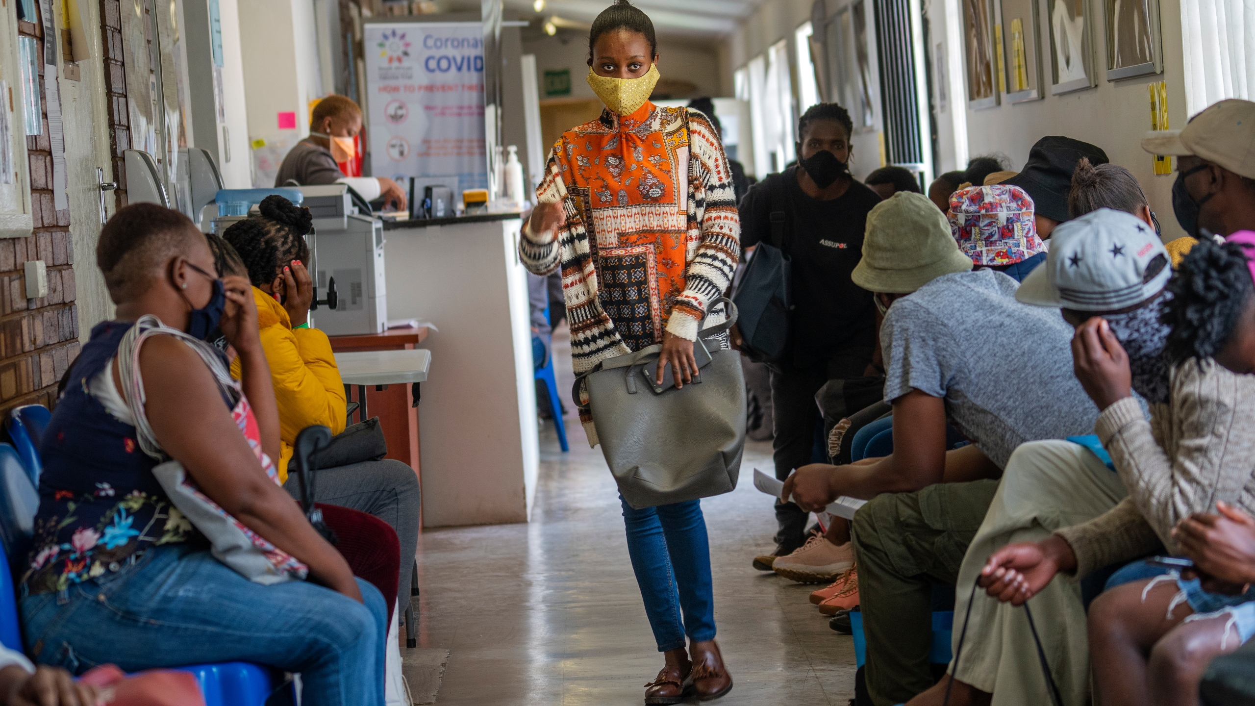 Volunteers wait to be checked at a vaccine trial facility for AstraZeneca at Soweto's Chris Sani Baragwanath Hospital outside Johannesburg, South Africa on Nov. 30, 2020. (AP Photo/Jerome Delay)