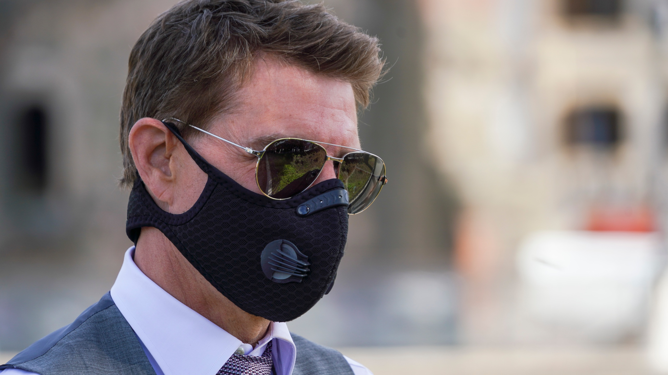 n this Tuesday, Oct. 13, 2020, file photo, actor Tom Cruise wears a face mask to prevent the spread of COVID-19 as he greets fans during a break from shooting Mission Impossible 7, along Rome's Fori Imperiali avenue. (AP Photo/Andrew Medichini, file)