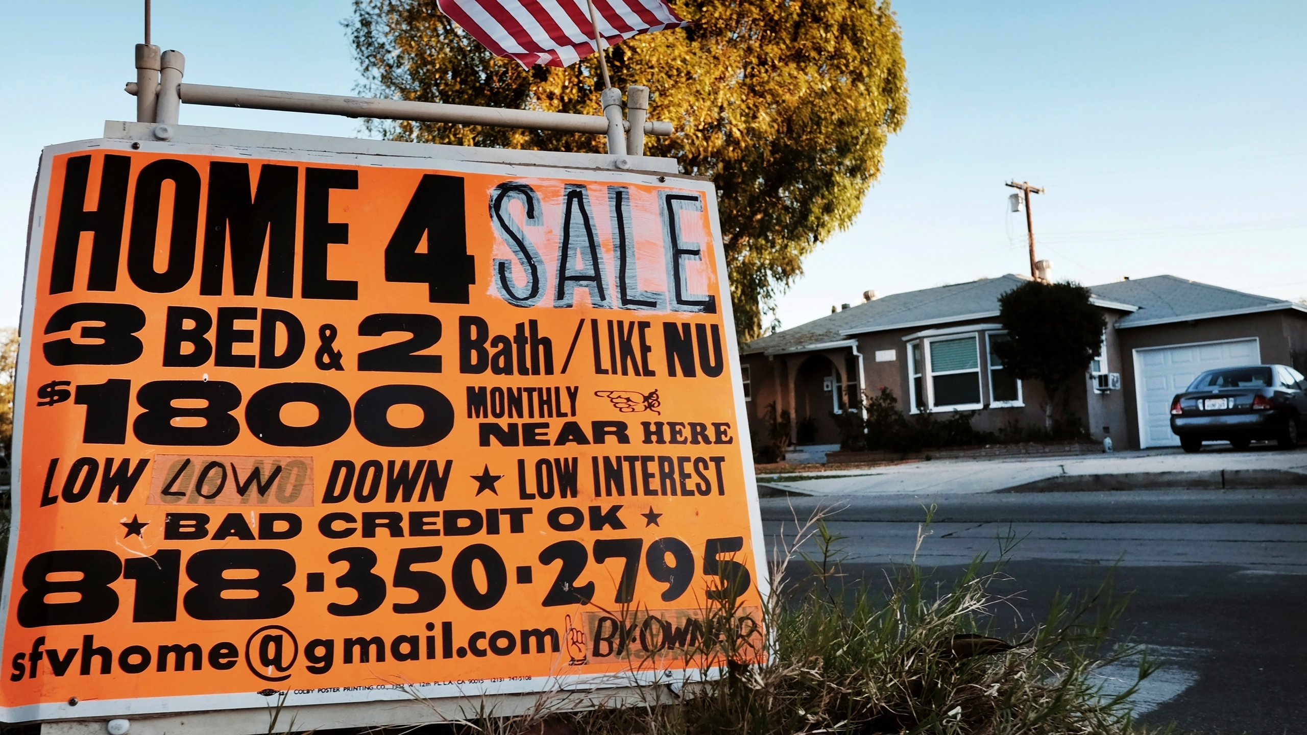 This Jan. 17, 2015, photo shows a sign advertising a house for sale in Los Angeles. (Richard Vogel / Associated Press)